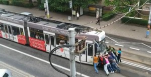 MPK Passengers Push Tram Back Into Place